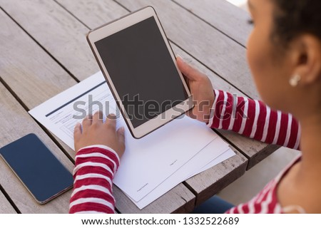 Overhead mid section view of  African American woman using her mobile phone on her terrace at home stock photo © wavebreak_media