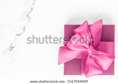 Pink gift box with silk bow on marble background, girl baby show Stock photo © Anneleven