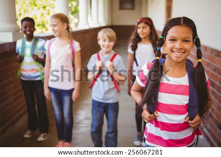 Front view of a cute mixed-race schoolgirl standing with football against green board in a classroom Stock photo © wavebreak_media