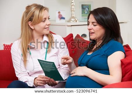 глядя листовка беременная женщина домой посещение женщину Сток-фото © HighwayStarz