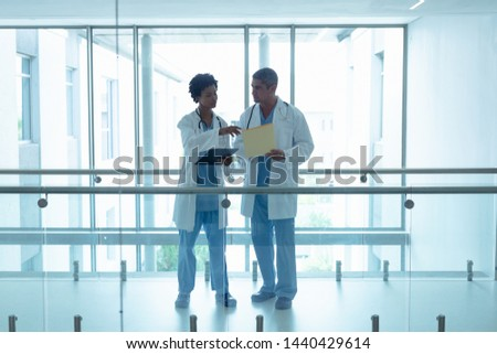 Front view of  diverse male doctors interacting with each other during seminar in conference room. Stock photo © wavebreak_media