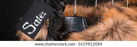 Banner schwarz Jacke Fell hängen Kleiderständer Stock foto © Illia