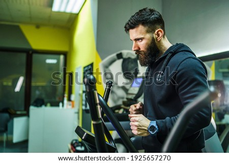 Endurance, wellbeing and sports concept. Handsome motivated sportsman in activewear, fitness equipme Stock photo © benzoix