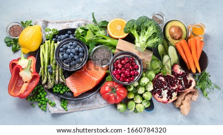 Healthy food concept. Various mixed fruits, vegetables and juices formed in rainbow Stock photo © dash