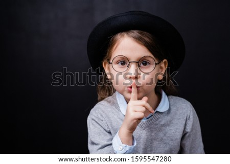 Adorable little girl in smart casualwear and eyeglasses asking you to keep quiet Stock photo © pressmaster