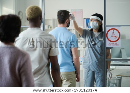 Front view of multi ethnic surgeons looking and discussing over x-ray in clinic at hospital Stock photo © wavebreak_media