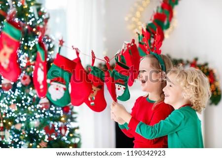 Kicsi fiú ajándék advent naptár tél Stock fotó © galitskaya