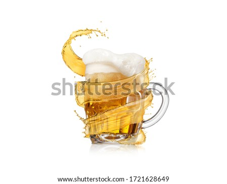 Flying spiral splash around mug of light fresh beer with thick foam. Stock photo © artjazz