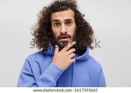 Afbeelding verward man aanraken kin toevallig Stockfoto © deandrobot