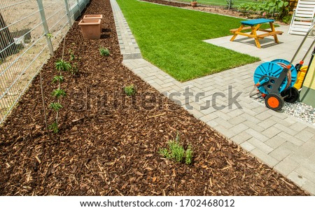 Garden with fresh new lawn, bark mulch area to reduce weed growth and your plants Stock photo © brebca