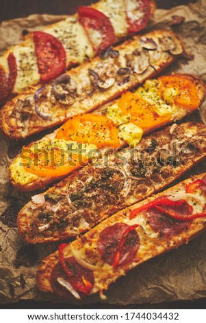 Composition of hot tasty baked sandwiches with various toppings. Stock photo © dash
