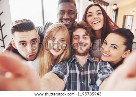 Image of young multinational women making fun and holding placards Stock photo © deandrobot
