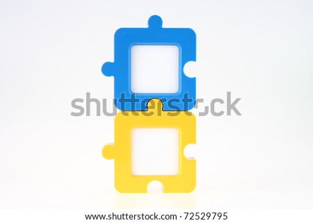 couple of vertical jigsaw shape photo frame in blue and yellow stock photo © pinkblue