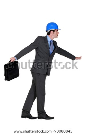 elated foreman in suit holding briefcase against white background Stock photo © photography33