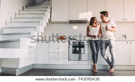 Attractive woman enjoying a cup of coffee while standing against a white background stock photo © wavebreak_media
