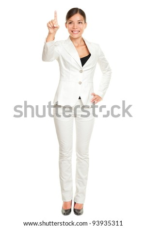 Young business woman pushing a button on a virtual touch screen  stock photo © HASLOO