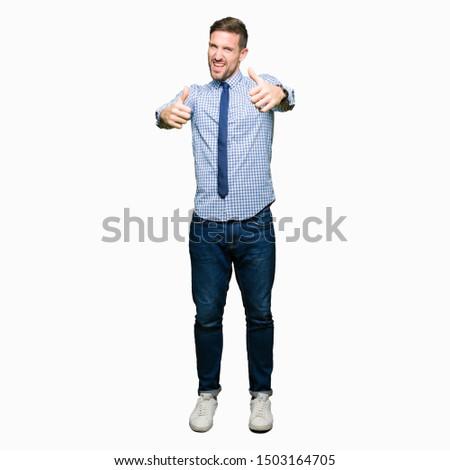 Retrato feliz jóvenes hombre de negocios Foto stock © HASLOO