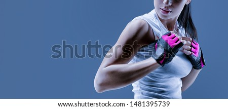 portrait of a young caucasian woman wearing a sports blue vest and drinks a bottle of energy drinks stock photo © ambro