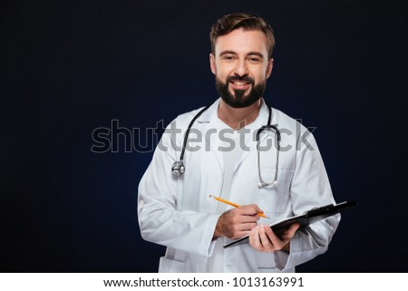 portrait of a smiling male doctor holding a notepad and finger u stock photo © vlad_star