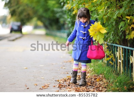 Beautiful girl in autumn clothing with a bunch of colorful leave Stock photo © Nejron