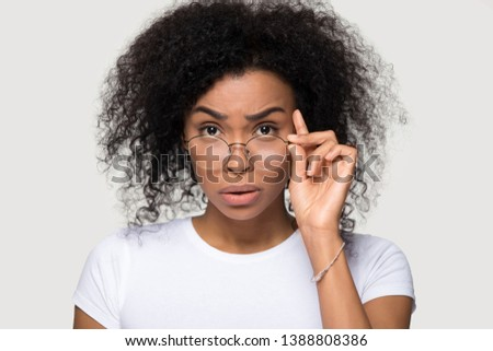 isolated mixed race stunned woman holding blank business card stock photo © feverpitch