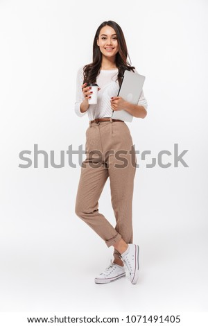 Full-length portrait of a attractive happy woman standing over gray background Stock photo © deandrobot
