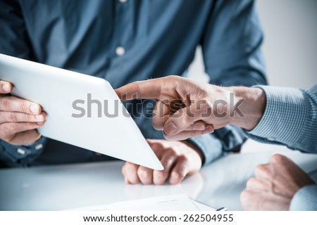 Two businessmen having a discussion. Closeup image of their hands on the table Stock photo © deandrobot