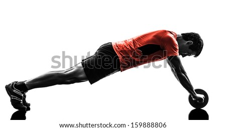 Man exercising fitness workout abdominal toning wheel overwhite background Stock photo © deandrobot