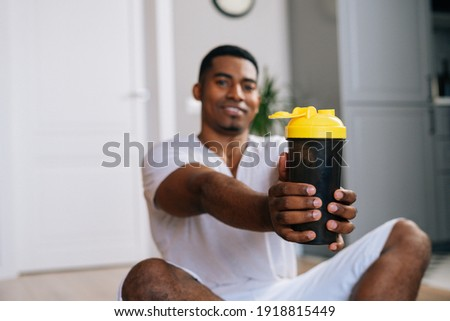 Portrait of confident young sportsman sitting with legs crossed Stock photo © deandrobot