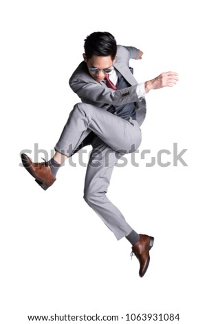 Happy businessman in sunglasses and suit shooting with water gun Stock photo © deandrobot