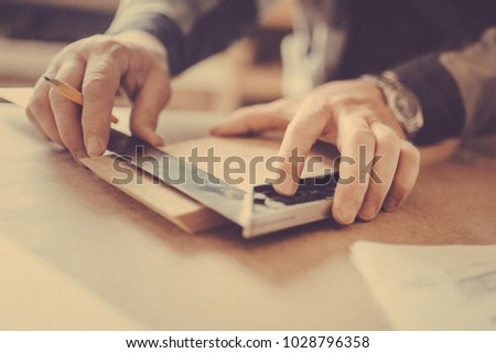 Stock photo: Male carpenter working with wood pencil and  tools at work place.Background craftsman tool.Zoom in1