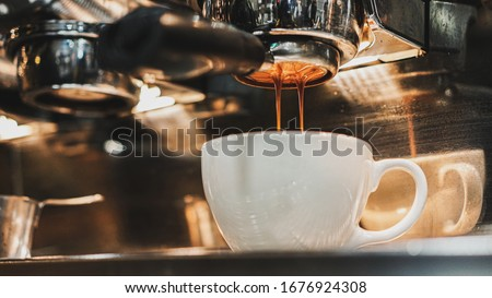 espresso extraction with a proffessional coffee machine, close up Stock photo © janssenkruseproducti