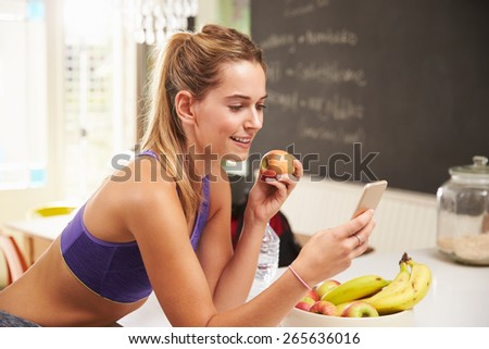 Smiling fitness woman texting on mobile phone and wearing earphones Stock photo © deandrobot