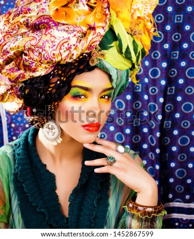 Stock photo: beauty bright african woman with creative make up, shawl on head like cubian closeup smiling, cheerf