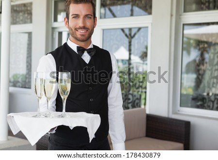 Portrait of smiling waiter holding champagne flute at counter Stock photo © wavebreak_media