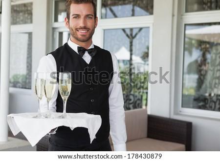 Retrato sorridente garçom champanhe flauta Foto stock © wavebreak_media