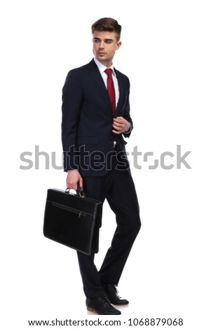 fashion business man with suitcase unbuttoning suit while walkin Stock photo © feedough
