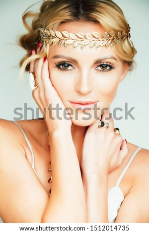 young blond woman dressed like ancient greek godess gold jewelr stock photo © iordani