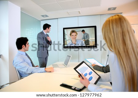 Stock photo: Business colleagues attending a video call in conference room