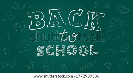 back to school inscription on green chalk blackboard chalk bo stock photo © popaukropa