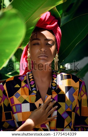 portrait of beautiful woman with colored headscarf and yellow su Stock photo © feedough