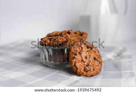 Healthy organic oat cookies with chocolate on wooden board on stone kitchen table background.  Stock photo © DenisMArt