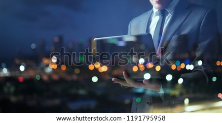 Businessman works with his laptop during the night. double exposure Stock photo © alphaspirit