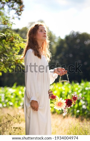 Girl in a red dress standing look up in the garden with hearts  Stock photo © Alones