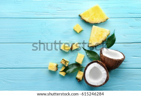 a fresh half of organic coconut and a palm leaf on a blue backgr stock photo © artjazz