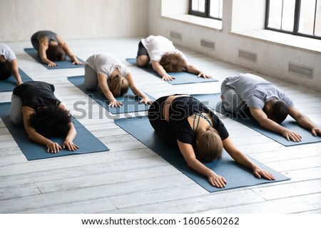 group of diverse people doing stretching exercise stock photo © andreypopov