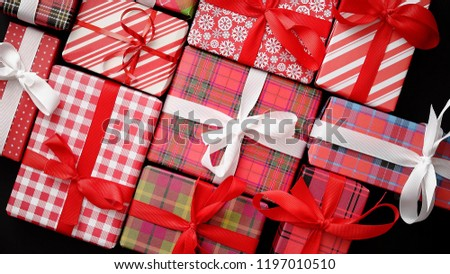 Top view of wrapped Christmas presents laid on the black background Stock photo © dash