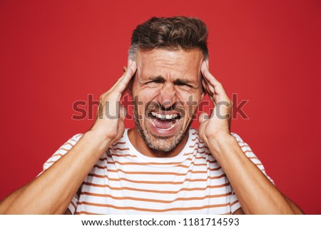 Adult man in striped t-shirt screaming and rubbing temples becau Stock photo © deandrobot