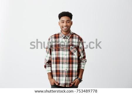 portrait of joyful casual man wearing shirt with checkers thinki Stock photo © feedough