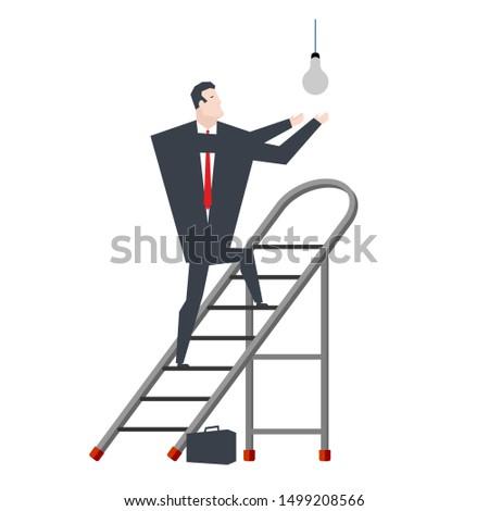 Empresario bombilla jefe portátil escalera hombre Foto stock © MaryValery